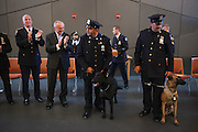 NYPD Commissioner William J. Bratton, Police Officer Andreas Savva, center, with Canine JC, honoring Police Officer Joseph Caputo, and Police Officer Thomas Regainer, right, with Canine Mikey, honoring Police Officer Michael Williams of the 47th Precinct, during the NYPD Transit Bureau Canine Unit Graduation Ceremony at the College Point Police Academy in Queens, NY on Tuesday, Oct. 6, 2015.<br /> <br /> Andrew Hinderaker for The Wall Street Journal<br /> NYSTANDALONE