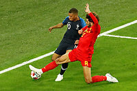 SAINT PETERSBURG, RUSSIA - JULY 10: Kylian Mbappe (L) of France national team and Marouane Fellaini of Belgium national team vie for the ball during the 2018 FIFA World Cup Russia Semi Final match between France and Belgium at Saint Petersburg Stadium on July 10, 2018 in Saint Petersburg, Russia. MB Media