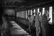 Infrared (IR) image - The betting windows at Keeneland Race Track.  I love the body language in this photograph and I appreciate the visual repetition that the betting windows provide.