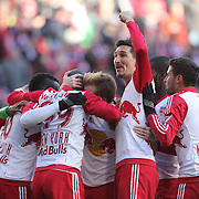 Sacha Kljestan salutes the crowd as New York Red Bulls players celebrate a Bradley Wright-Phillips goal during the New York Red Bulls Vs D.C. United, Major League Soccer regular season opening match at Red Bull Arena, Harrison, New Jersey. USA. 22nd March 2015. Photo Tim Clayton