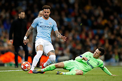 Manchester City's Kyle Walker is challenged during the UEFA Champions League round of 16 second leg match at the Etihad Stadium, Manchester.