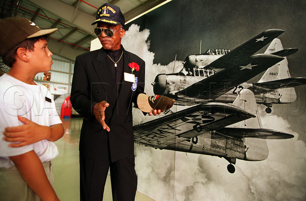 Jason Hidalgo, 11, talks with Tuskegee airman Eldridge Williams at Weeks museum after viewing the HBO drama Tuskegee Airmen. Tamiami Airport, Miami