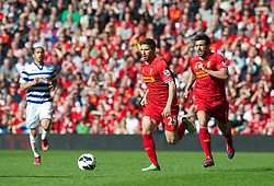 LIVERPOOL, ENGLAND - Sunday, May 19, 2013: Liverpool's Fabio Borini and Jose Enrique in action against Queens Park Rangers during the final Premiership match of the 2012/13 season at Anfield. (Pic by David Rawcliffe/Propaganda)