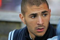 Karim Benzema of Real Madrid sits on the bench during the Pre Season Friendly between Shamrock Rovers and Real Madrid at Tallaght Stadium on July 20, 2009 in Dublin, Ireland