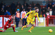 Bristol Rovers striker Matty Taylor gets the better of Crawley Town defender Mitch Hancox during the Sky Bet League 2 match between Crawley Town and Bristol Rovers at the Checkatrade.com Stadium, Crawley, England on 21 November 2015. Photo by Bennett Dean.