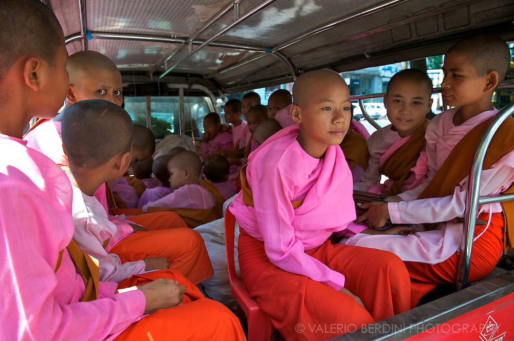 A group of Samaneras (novices) on a van in Rangoon. Women monastic period lasts five years before becoming a Bhikkhuni (monk).