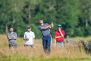 Benjamin Hebert (FRA) plays his second shot on the 14th hole during the final round of the Aberdeen Standard Investments Scottish Open at The Renaissance Club, North Berwick, Scotland on 14 July 2019.