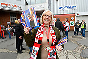 Programme seller in Red Square before the EFL Sky Bet League 2 match between Exeter City and Grimsby Town FC at St James' Park, Exeter, England on 29 December 2018.
