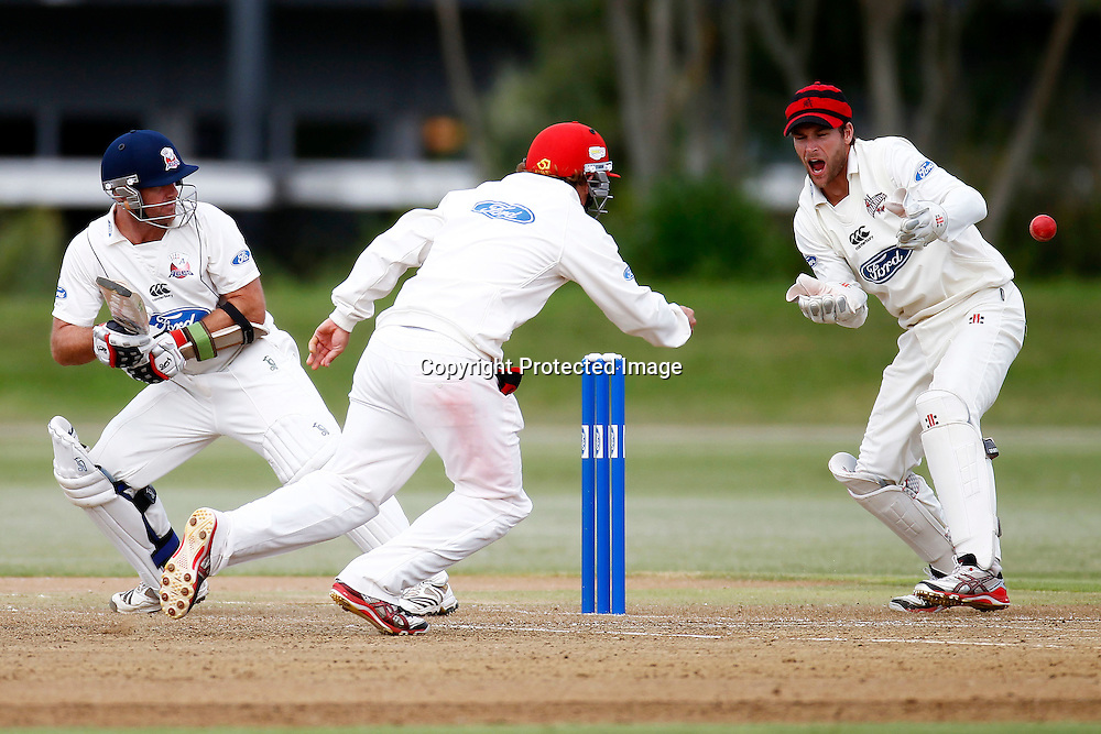 Gareth Hopkins in action as keeper Reece Young reacts, Plunket shield cricket. Auckland Aces v Canterbury Wizards. 4 Day domestic cricket. Colin Maiden Park, Auckland. 26 March 2012. Photo: William Booth/photosport.co.nz