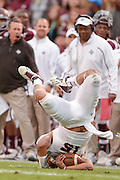 Nov 9, 2013; College Station, TX, USA; Mississippi State Bulldogs quarterback Dak Prescott (15) flips as he is tackled against the Texas A&M Aggies during the second half at Kyle Field. Texas A&M won 51-41. Mandatory Credit: Thomas Campbell-USA TODAY Sports