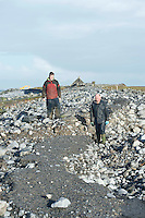07/01/2014.  Padraig and his father Roger Fahy from Linnalla Icecream in Burren Newquay   surveying the damage to the flaggy shore road, which was washed away in the recent storms. The Flaggy shore written about by Seamus Heaney is a popular daily walking spot. Photo:Andrew Downes.