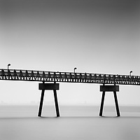 Metal jetty structure over sea with long exposure