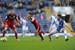 Bristol City's Paul Anderson is fouled by Blackburn Rovers' Grant Hanley - Photo mandatory by-line: Joe Meredith/JMP  - Tel: Mobile:07966 386802 05/01/2013 - Blackburn Rovers v Bristol City - SPORT - FOOTBALL - FA Cup -  BLACKBURN - EWOOD PARK -