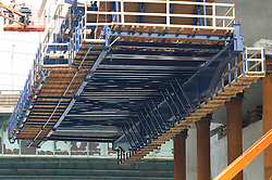 Supports and Cast-in-place underpinnigs, New Pearl Harbor Memorial Bridge under Construction at New Haven Harbor Crossing, Connectictut. CONNDOT Contract B, Project #92-618. When complete the alternately named Quinnipiac River Bridge will be first Extradosed Engineered & Designed Bridge in the United States.