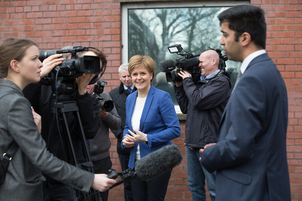 FIRST MINISTER STURGEON TO MEET WORKFORCE AT GOVAN SHIPYARD. Nicola Sturgeon (C) walking along Govan Rd, Glasgow to meet workers at the BAE Shipyard in Govan.  With local candidates Humza Yousaf (R). Picture Robert Perry 25th April 2016<br /> <br /> Must credit photo to Robert Perry<br /> FEE PAYABLE FOR REPRO USE<br /> FEE PAYABLE FOR ALL INTERNET USE<br /> www.robertperry.co.uk<br /> NB -This image is not to be distributed without the prior consent of the copyright holder.<br /> in using this image you agree to abide by terms and conditions as stated in this caption.<br /> All monies payable to Robert Perry<br /> <br /> (PLEASE DO NOT REMOVE THIS CAPTION)<br /> This image is intended for Editorial use (e.g. news). Any commercial or promotional use requires additional clearance. <br /> Copyright 2014 All rights protected.<br /> first use only<br /> contact details<br /> Robert Perry     <br /> 07702 631 477<br /> robertperryphotos@gmail.com<br /> no internet usage without prior consent.         <br /> Robert Perry reserves the right to pursue unauthorised use of this image . If you violate my intellectual property you may be liable for  damages, loss of income, and profits you derive from the use of this image.