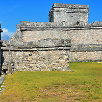 Temple of the Initial Series at Mayan Ruins in Tulum, Mexico<br /> Just south of El Castillo is the Temple of the Initial Series. Not much is known about Templo de la Serie Inicial. However, it is famous among archeologists based on the explorations of John Lloyd Stevens in the mid-19th century. He discovered a stela which is a large carved stone.  Tulum Stela 1 shows a Mayan king surrounded by Mayan hieroglyphs (script).  This limestone pillar dates from 564 AD, hundreds of years before Tulum was built. The historic artifact is now exhibited in London&rsquo;s British Museum.