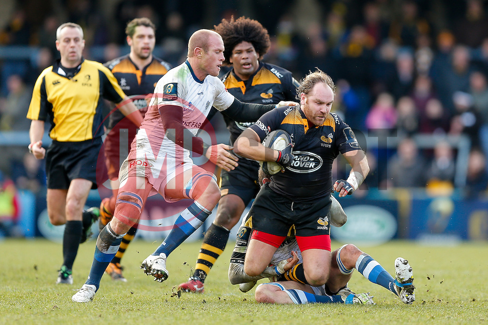 Wasps Fly-Half Andy Goode is tackled by Castres Olympique Number 8 Jannie Bornman - Photo mandatory by-line: Rogan Thomson/JMP - 07966 386802 - 14/12/2014 - SPORT - RUGBY UNION - High Wycombe, England - Adams Park Stadium - Wasps v Castres Olympique - European Rugby Champions Cup Pool 2.