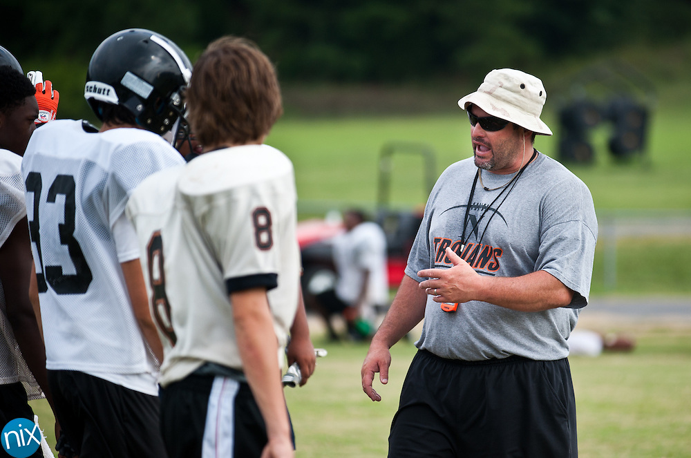 Northwest Cabarrus' head coach Rich Williams works with his players during football practice Tuesday, July 31  at Northwest Cabarrus High School. (photo by James Nix)