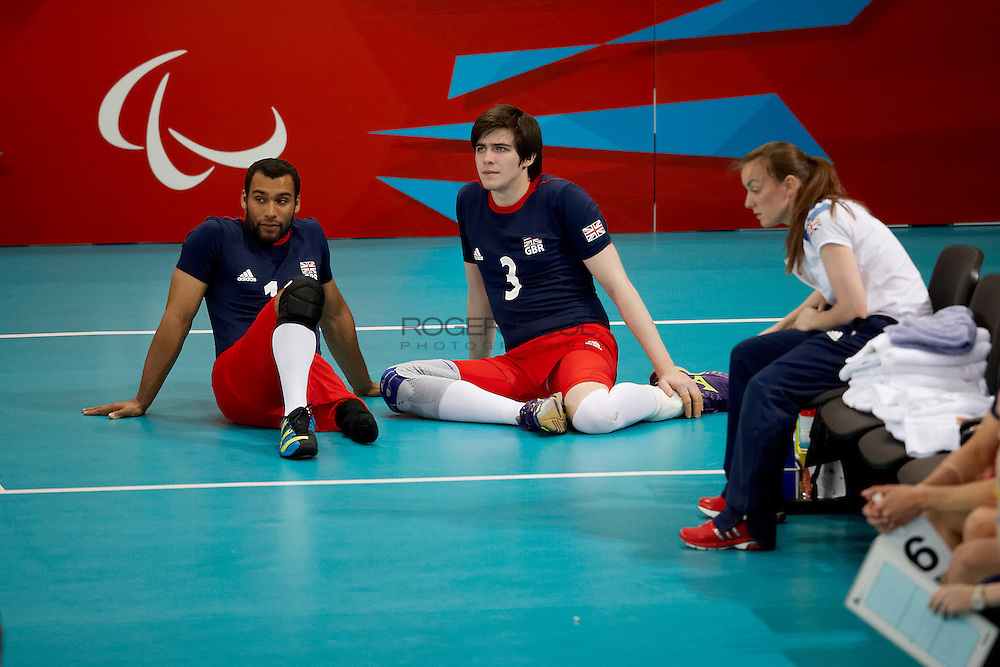 James Roberts and Sam Scott wait on the side line with the Great Britain Men's sitting volleyball team loose to  Egypt at the Excel centre on day 2 of the London 2012 Paralympic Games. 31st August 2012