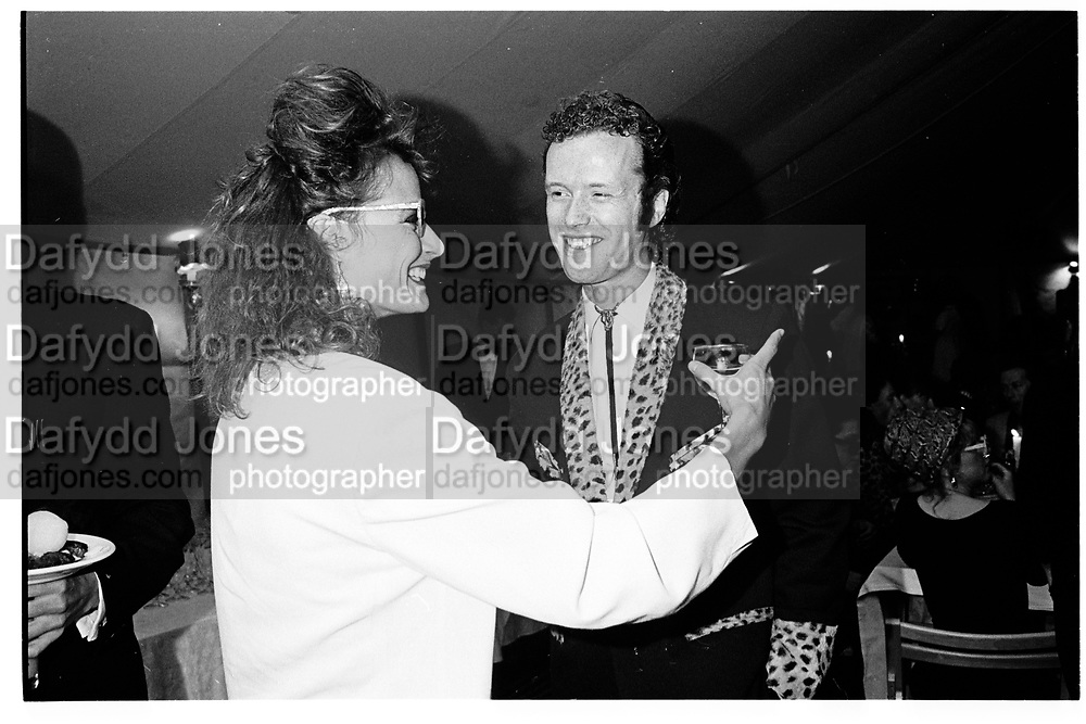 The Marchioness of Worcester and Teddy St. Aubyn. Sixties party given by Erskine and Louise Guinness. Ludgershall. 25 July 1987. SUPPLIED FOR ONE-TIME USE ONLY> DO NOT ARCHIVE. © Copyright Photograph by Dafydd Jones 66 Stockwell Park Rd. London SW9 0DA Tel 020 7733 0108 www.dafjones.com