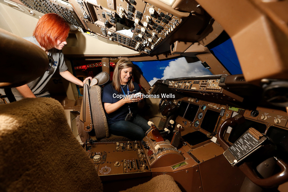Thomas Wells | Buy at PHOTOS.DJOURNAL.COM<br /> Cortnie Jackson, left, and Brittney Taylor from United Assest management get their companies 747 cockpit in preparation for this week's Career Fair being held at the BancorpSouth Arena and BancorpSouth Conference Center.