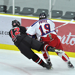 COBOURG, ON - Oct 12 : Ontario Junior League Game Action between, Milton Icehawk's Hockey Club and the North York Ranger's Hockey Club at the OJHL Governors Showcase Tournament. #12 Jake Baird of the Milton Icehawk's takes a hit from #19 Taylor Pryce of the North York Rangers during second period game action. .(Photo by Jennifer-Rose DeVincentis / OJHL Images