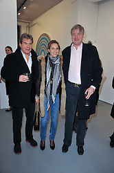 Left to right, HUGO DE FERRANTI, CHRISTINE d'ORNANO and The MARQUESS OF WORCESTER at the Hopes & Dreams Private View - a film installation by Gerry Fox for The Hoping Foundation held at Sadie Coles Gallery, 4 New Burlington Place, London
