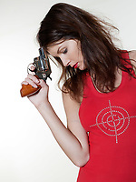 studio portrait of a beautiful woman on isolated on white background holding gun