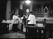 Archbishop Ryan Installed as Archbishop of Dublin..1972..27.02.1972..02.27.1972..27th February 1972..The installation of the Most Rev Dr Dermot Ryan as Archbishop of Dublin took place in The pro Cathedral,Dublin on Sunday 27th Feb 1972..Picture shows Dr Dermot Ryan accepting the Papal Bull symbol of office to confirm his installation of Archbishop Of Dublin.