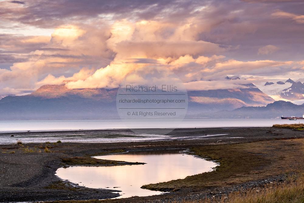 A storm clouds part at sunset over Grewingk Glacier on Kachemak Bay in Homer, Alaska.