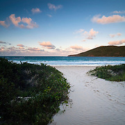 The sun sets over Flamenco Beach, a world-famous white-sand beach located on the north shore of the island of Culebra, a satellite of Puerto Rico.
