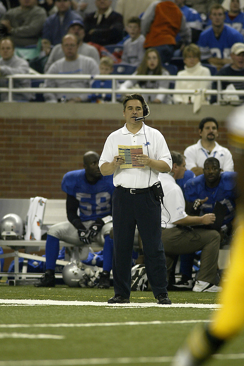 Head Coach Steve Mariucci of the Detroit Lions watches his team from the sidelines during their 22-14 victory over the Green bay Packers on 11/27/2003. ©JC Ridley/NFL Photos.