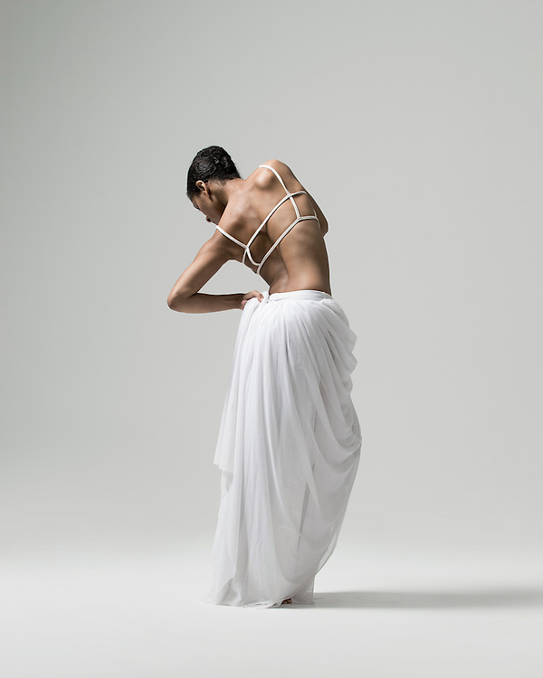 Contemporary female dancer, Blair Reavis-Tyler, photographed in the photo studio on a white background. Photograph taken in New York City by photographer Rachel Neville.