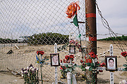 A shrine for Armando Ramirez, 16, and his brother Heladio Ramirez, 22, sits outside the gates of Community Recycling & Resource Recovery Inc. in Arvin, Calif. Two years ago, the brothers died from inhaling the poisonous gas hydrogen sulfide while cleaning out a drainage shaft at the facility. The facility handles the disposal of bio-waste from Los Angeles. Many residents of Arvin and Kern County oppose the site because of the air pollution the facility emits.