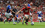 Wayne Rooney of Manchester United takes on Stephen Carr and Franck Queudrue during the Barclays Premier League match between Manchester United and Birmingham City at Old Trafford on August 16, 2009 in Manchester, England.