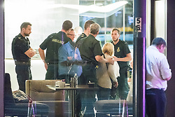 © Licensed to London News Pictures. 10/08/2017. Salford, UK. Police , paramedics and bystanders in the foyer of the Marriott Hotel which is next door to and shares a car park with the Ibis Hotel .  The scene at the Ibis hotel in Salford Quays where a young boy was killed in a collision with a car earlier this evening (Thursday 10th August 2017) . Photo credit: Joel Goodman/LNP