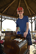 Organ grinder IAN FRASER, 13, of Staten Island, is playing his 1881 Celestina Organette, made by the Mechanical Orguinette Company of New York, on the boardwalk at the Fourth Annual History Day at Deno's Wonder Wheel Amusement Park and The Coney Island History Project. Fraser is one of the youngest members of AMICA, the Automatic Musical Instrument Collectors' Association, and COAA, the Carousel Organ Association of America.