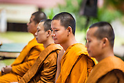 29 JUNE 2014 - DAN SAI, LOEI, THAILAND:  Buddhist monks at a merit making ceremony at Wat Ponchai on the last morning of the ghost festival. Phi Ta Khon (also spelled Pee Ta Khon) is the Ghost Festival. Over three days, the town's residents invite protection from Phra U-pakut, the spirit that lives in the Mun River, which runs through Dan Sai. People in the town and surrounding villages wear costumes made of patchwork and ornate masks and are thought be ghosts who were awoken from the dead when Vessantra Jataka (one of the Buddhas) came out of the forest. On the last day of the festival people participate in merit making ceremonies at the Wat Ponchai in Dan Sai and lead processions through town soliciting donations for the temple.   PHOTO BY JACK KURTZ