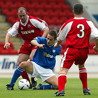 St Johnstone v Brechin City....30.08.03<br />Paul Bernard battles with Kevin Fotheringham<br /><br />Picture by Graeme Hart<br />Perthshire Picture Agency<br />Tel: 01738 623350 / 07990 594431