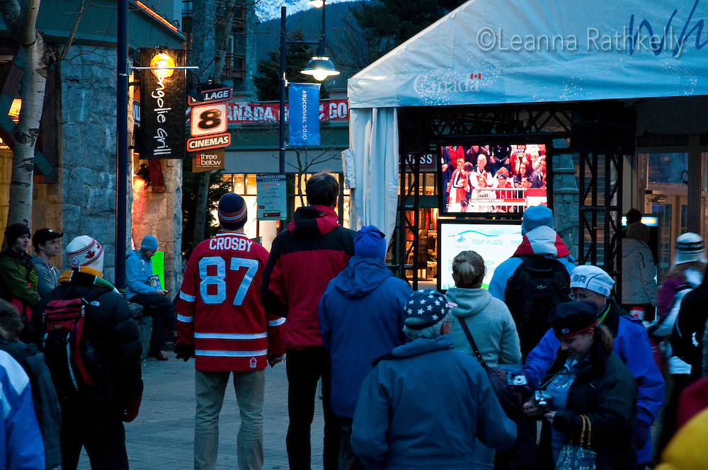 A Crosby fan watches the Olympic games on one of the many TV screens located around the village during the 2010 Olympic Winter Games in Whistler, BC Canada