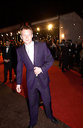Paul Bettany arriving for the Baftas, Leicester Sq. 23  February 2003. © Copyright Photograph by Dafydd Jones 66 Stockwell Park Rd. London SW9 0DA Tel 020 7733 0108 www.dafjones.com