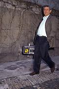 Piero Scaramucci, editor of Radio Popolare (Popular Radio) poses in the new headquarter of the radio at Stradella street, in Milan, 1992. Radio Popolare is an Italian free and indipendent radio station; its programs are broadcasted on FM and streaming and by satellite. Scaramucci has been editor of the radio from 1992 to 2002. &copy; Carlo Cerchioli<br /> <br /> Piero Scaramucci, direttore responsabile di Radio Popolare, posa nella nuova sede della radio in via Stradella a Milano, 1992. Radio Popolare, &egrave; una radio di informazione libera e indipendente; i suoi programmi sono trasmessi in FM e streaming e via satellite. Scaramucci &egrave; stato direttore della radio dal 1992 al 2002.