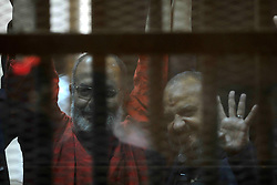 """16.05.2015, Kairo, EGY, Mohamed Mursi Prozess, im Bild Ein Gericht in Kairo hat den ehemaligen ägyptischen Präsidenten Mohammed Mursi wegen Spionage heute zum Tode verurteilt. // Egyptian Muslim Brotherhood top figure, Mohamed el-Beltagy flashes the four finger symbol known as """"Rabaa"""" from behind the defendant's cage as the judge reads out the verdict sentencing him and more than 100 other defendants at a court in the outskirts of Cairo, May 16, 2015. An Egyptian court on Saturday sought the death penalty for former president Mohamed Mursi and more than 100 other members of the Muslim Brotherhood in connection with a mass jail break in 2011. Photo by Stringer, Egypt on 2015/05/16. EXPA Pictures © 2015, PhotoCredit: EXPA/ APAimages/ Stringer<br /> <br /> *****ATTENTION - for AUT, GER, SUI, ITA, POL, CRO, SRB only*****"""