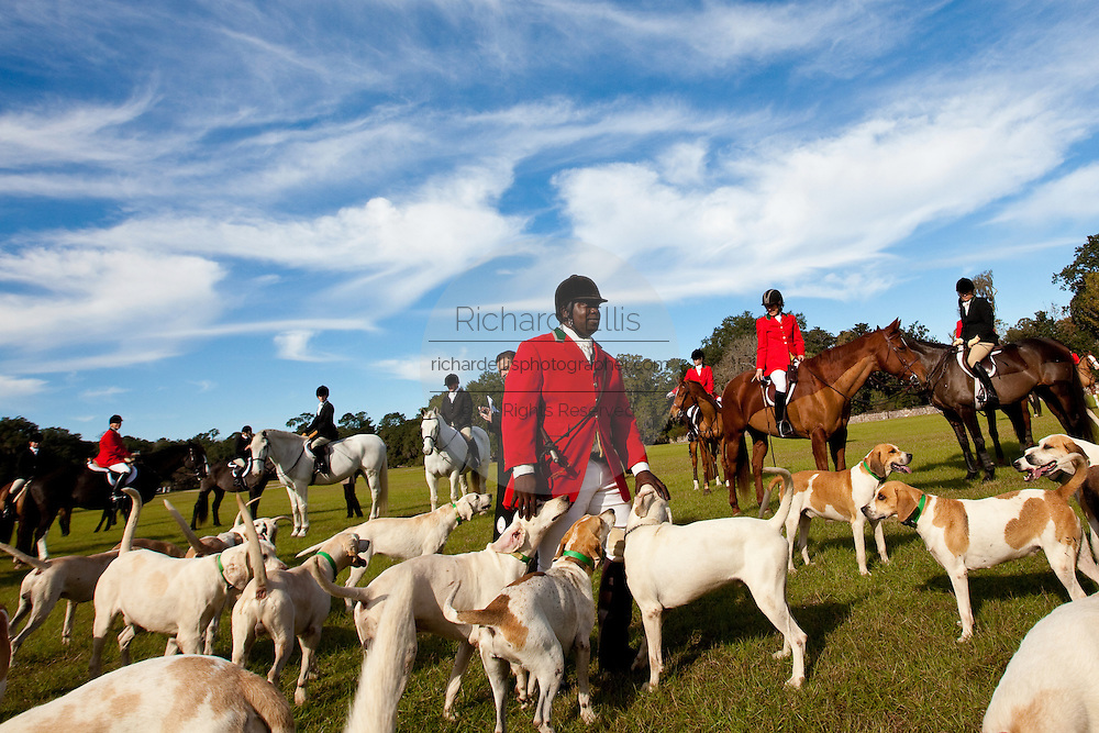 Jamie Greene, master of the hounds at the Middleton Place Fox Hunt before the start of the hunt on the greensward of the plantation house at Middleton Place plantation in Charleston, SC. The hunt is a drag hunt where a scented cloth is used instead of live fox.