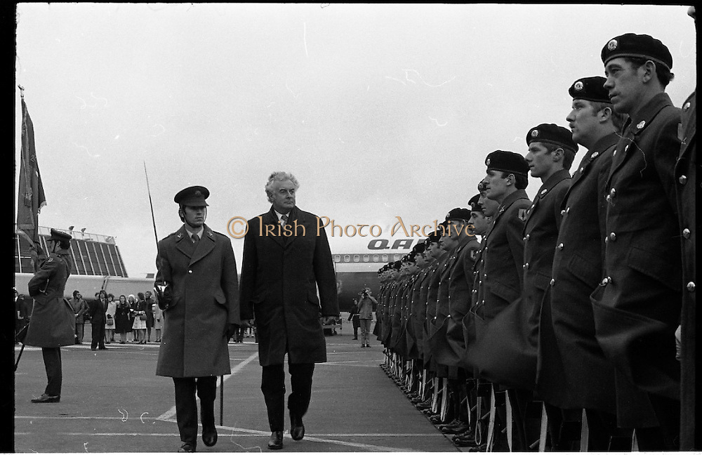 Australian Prime Minister Visits Ireland.   (H79)..1974..23.12.1974..12.23.1974..23rd December 1974..As part of his tour of E.E.C. Capital Cities,Mr Gough Whitlam, the Australian Prime Minister visited Dublin today. In Dublin he will have talks with An Taoiseach, Mr Liam Cosgrave...Pictured reviewing the military guard of honour, The Australian Prime Minister,Mr Gough Whitlam inspects the soldiers.