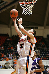 Jason Cain (33) with a lay up against Northwestern.  Cain had 7 rebounds and 3 points as UVA beat the Wildcats 72-57 in the ACC/BigTen Challenge...The Virginia Cavaliers Men's Basketball team defeated the Northwestern Wildcats 72-57 in the ACC/BigTen Challenge at University Hall in Charlottesville, VA on November 30, 2005..