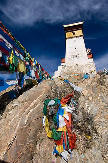 Tibetan Prayer Flags strung along the hillsides of Tibet. Asia.