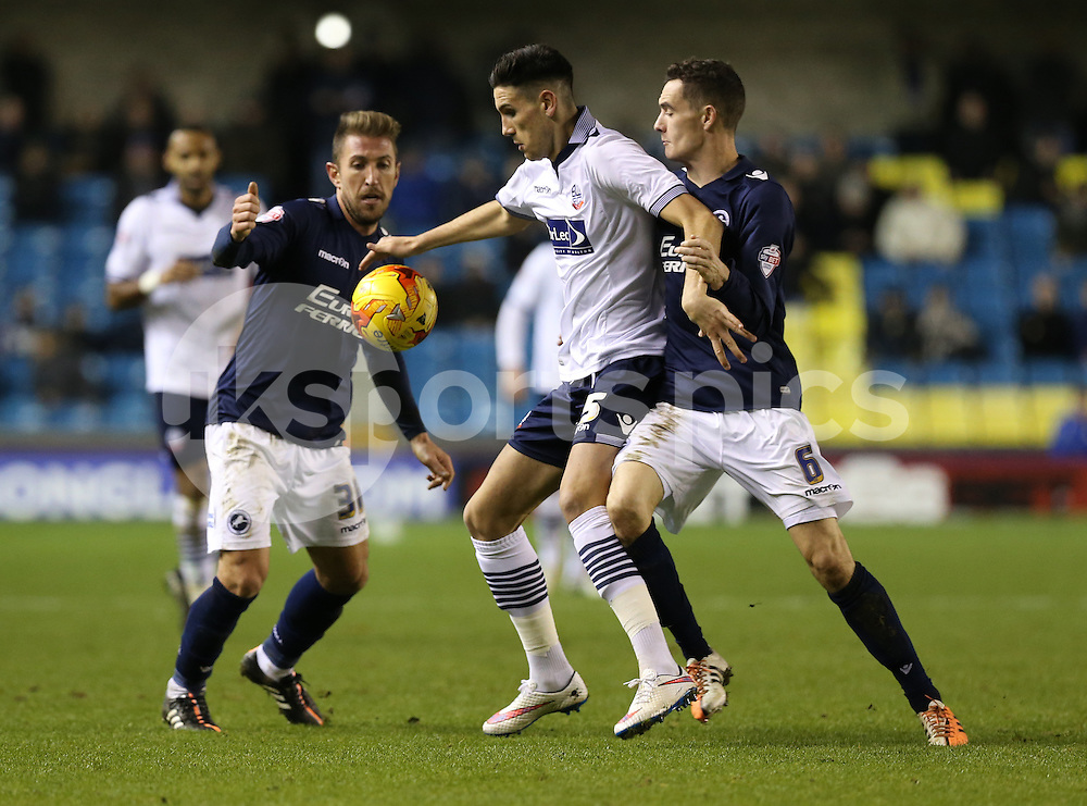 Bolton's Connor Wilkinson is the filling in the sandwich during the Sky Bet Championship match between Millwall and Bolton Wanderers at The Den, London, England on 19 December 2014. Photo by Dave Peters.