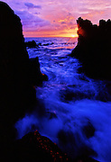 Surf at sunset on the rocky shore - Waimea, Maui
