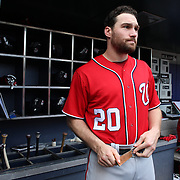 NEW YORK, NEW YORK - July 10: Daniel Murphy #20 of the Washington Nationals in the dugout preparing to bat during the Washington Nationals Vs New York Mets regular season MLB game at Citi Field on July 10, 2016 in New York City. (Photo by Tim Clayton/Corbis via Getty Images)